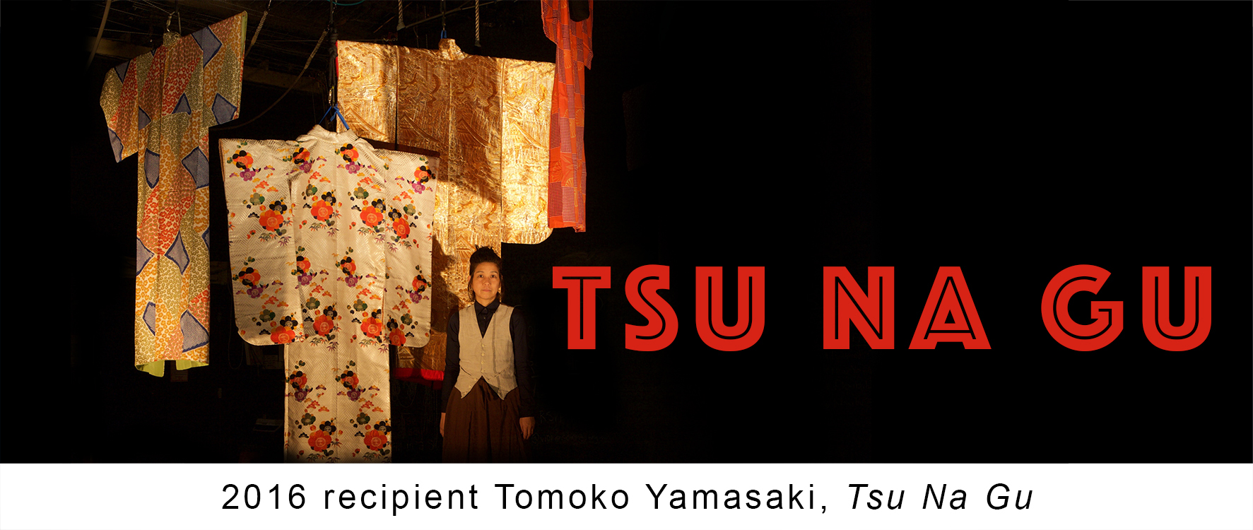Tsu Na Gu promotional poster, featuring woman standing next by various fabrics.