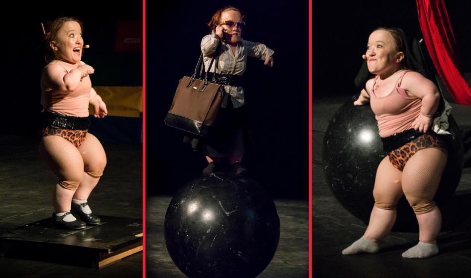 A woman performing on stage with a ball.