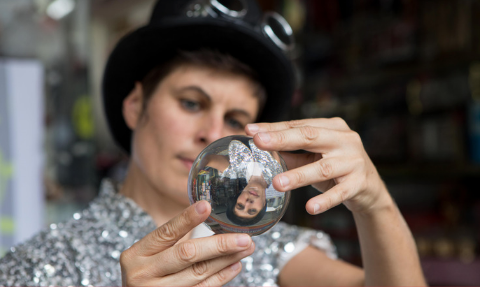 A person gazing into a crystal ball.