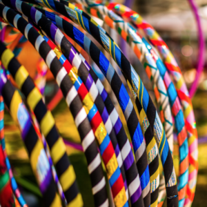 A bunch of colourful hula hoops.