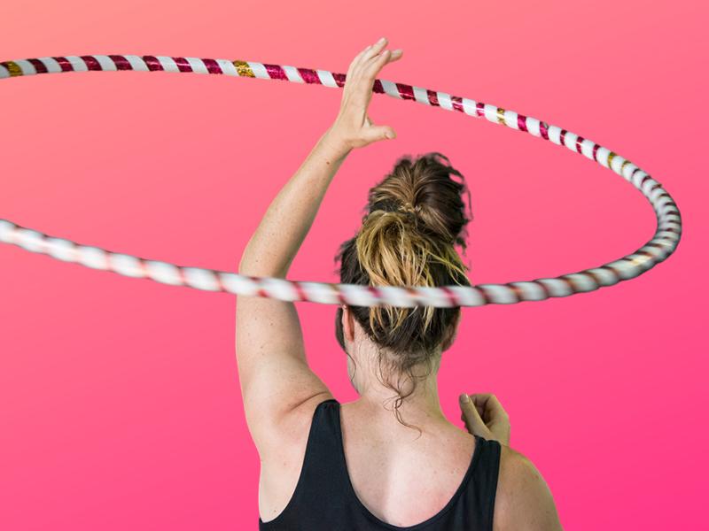 Women's Circus gift certificate hula hoop over the head